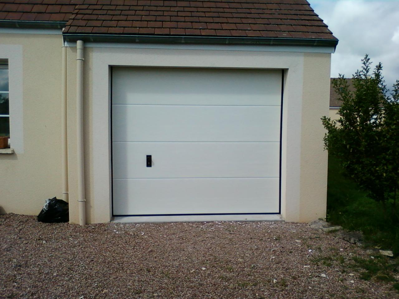 Portes de garage sectionnelle - Pose d une porte de garage sectionnelle ...